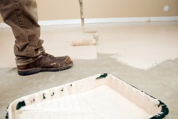 Painter painting garage floor in Sydney