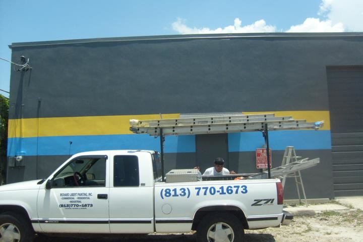 Commercial Exterior Painting with decorative stripe of Auto Garage in downtown Tampa, FL