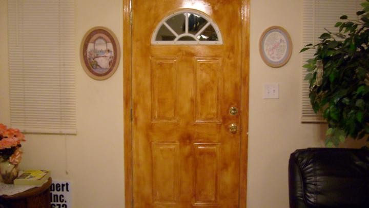 Residential Metal door grained to look like wood Tampa