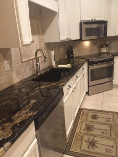 Cabinet Refinishing and Backsplash installation
